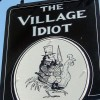 village idiot sign